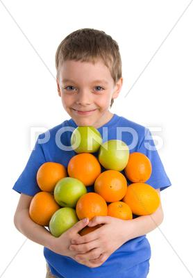 Stock photo of boy with apples and oranges