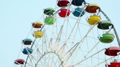 Ferris wheel circling with illumination and passenger in cabins Stock Footage