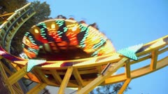 People ride on round circling attraction which sways Stock Footage