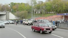 Traffic on road with police near quay of Yauza river Stock Footage
