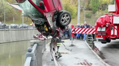 EMERCOM serviceman takes part of crashed car Stock Footage