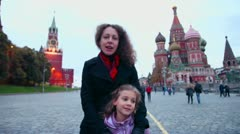 Daughter stands with mother which speaks on Red Square Stock Footage