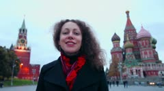 Woman speaks near Spasskaya tower and St. Basils cathedral Stock Footage