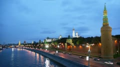 Ship sail by river with traffic on quay near Kremlin wall Stock Footage