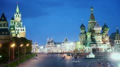 Spasskaya Tower and St Basils Cathedral in Red Square at night Stock Footage