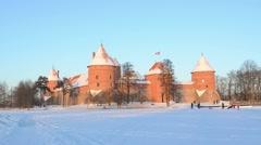 Beautiful sunset Trakai castle snow people tourists leisure Stock Footage