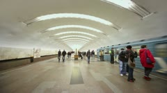 People walk by platform during arrival of train to metro station Stock Footage