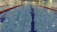 Sportsman swimming the breaststroke in swimming pool with turn somersaults Stock Footage