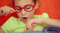 Little girl reads russian letters, confuses then makes mistake Stock Footage