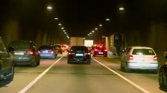 Many cars make jam in dark tunnel with illumination Stock Footage