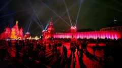 Stock Video Footage of Projectors rays in dark sky above crowd on Red Square