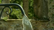 Fountain at the entrance to the town of Ternand France Stock Footage