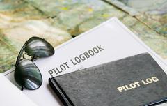 Sunglasses and logbook Stock Photos