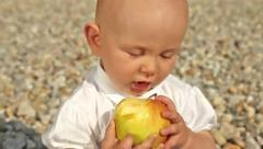 Baby doesn't like apple - close up Stock Footage