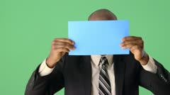 African American Businessman holding paper up to camera Stock Footage