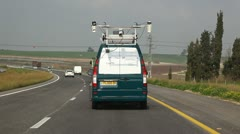 Road and airport survey van inspects Road 6 Stock Footage