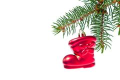 Red christmas star hanging from tree Stock Photos