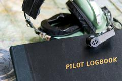 Logbook and headset Stock Photos