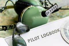 logbook and other tools - stock photo