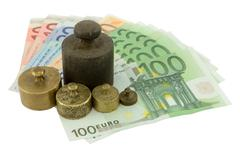 Weights on euro money Stock Photos
