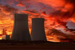 Nuclear power plant with an intense red sky Stock Photos