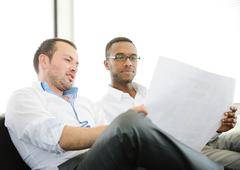 group of multi ethnic business people at work discussing a project - stock photo