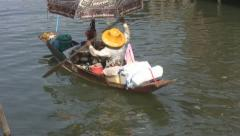 Old Lady Selling Food from a Boat at Amphawa p33 Stock Footage