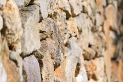 Selective focus of a dry-stone wall Stock Photos
