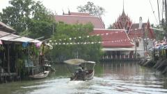A Tourist Boat with Temple in the Backgraound at Amphawa p21 - stock footage