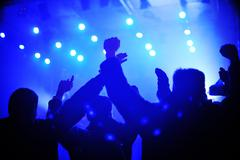 Stock Photo of concert crowd in front of bright stage lights