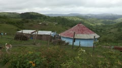 A rural Transkei landscape with hut in the foreground. Stock Footage