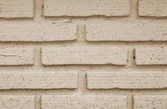 sepia brick wall texture background - stock photo