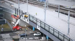Workers change a covering on the bridge cars move under it Stock Footage