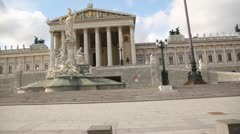 Parlament Vienna with big fountain statue in Vienna, Austria Stock Footage