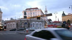 People and cars go near to Albertina Museum at day Stock Footage