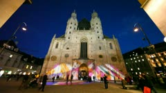 People go near St. Stephen church at evening in Vienna Stock Footage
