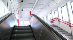 The escalator moves in an empty hall with windows and daylight. Stock Footage