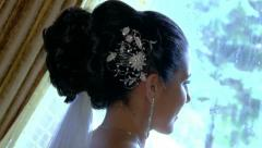 Bride Looking Out Window Holding Flowers - stock footage