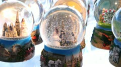 Many christmas snow balls with winter city, girls, castle. Stock Footage