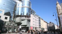 People go on square near St. Stephen church and Haas Haus at day Stock Footage