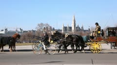 The carriages with horses moves on city center Vienna Austria Stock Footage
