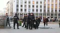 Police officers do a protection in center of city Stock Footage