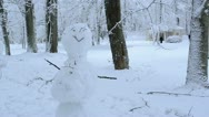 Snowman stand trees covered snow people walking winter park Stock Footage
