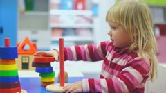 Adorable girl play with toys in mall Stock Footage