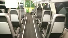 Empty salon of modern bus which goes on night city Stock Footage