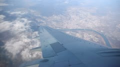 Wing and the city are visible from a plane window. Stock Footage