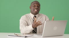 African American business man talking to someone off screen Stock Footage