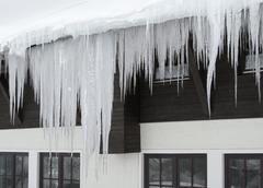 Stock Photo of icicles and house facade