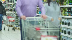 Customers in alcohol beverages department in supermarket Stock Footage