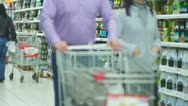 Stock Video Footage of Customers in alcohol beverages department in supermarket